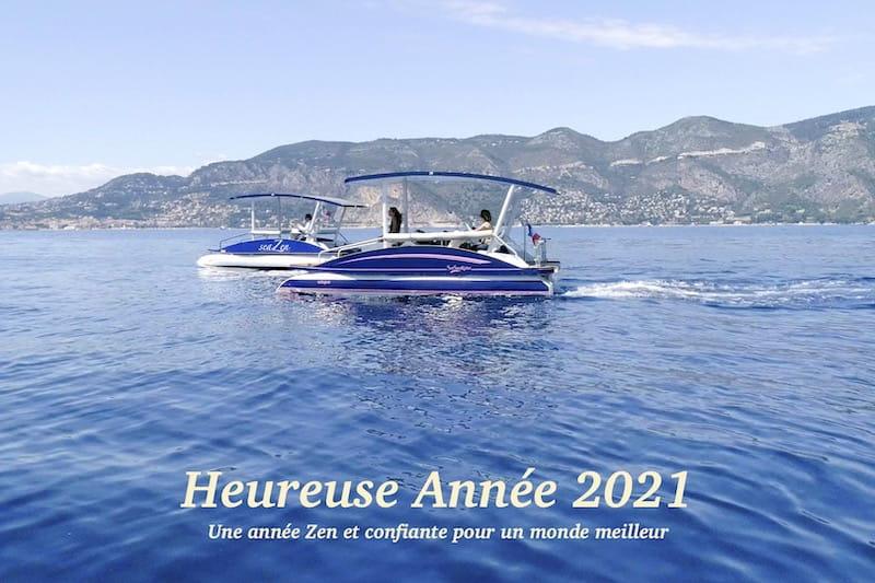 2021 greetings representing 2 seaZen solar powered boats
